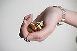 Caucasian woman holding bullets