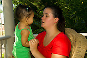 MR / Schenectady, NY. Mother (20) talks to her infant daughter (girl, 9 months, African American & Caucasian). MR: Dal4, Dal6. ID: AL-HD. © Ellen B. Senisi