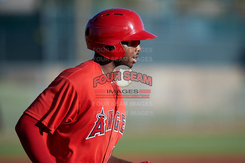 AZL Angels Trent Deveaux (17) jogs to first base after drawing a walk during an Arizona League game against the AZL Giants Black at the Giants Baseball Complex on June 21, 2019 in Scottsdale, Arizona. AZL Angels defeated AZL Giants Black 6-3. (Zachary Lucy/Four Seam Images)
