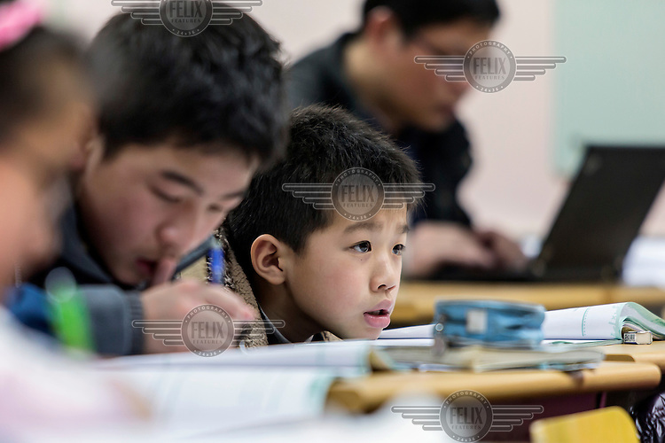 Fifth grade students during a three hour long Saturday Mathematics Olympiad class at the Xueersi cram school. With their future success pinned on their academic performance at a very early age, Chinese students and their parents are under pressure to improve their academic performance in every perceivable way.