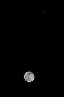 So near and yet so far, the nearly full moon (the day before) and Jupiter, passing in the night as seen from a backyard in the San Francisco Bay area.