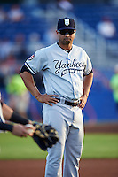 Staten Island Yankees coach Teuris Olivares (13) during warmups before a game against the Batavia Muckdogs on August 27, 2016 at Dwyer Stadium in Batavia, New York.  Staten Island defeated Batavia 13-10 in eleven innings.  (Mike Janes/Four Seam Images)