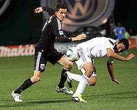 Mark Burch (4) of D.C. United clashes with Miguel Lopez (25) of the Los Angeles Galaxy during an MLS match at RFK Stadium, on April 9 2011, in Washington D.C.The game ended in a 1-1 tie.
