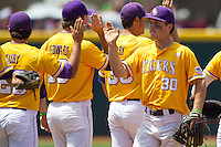 LSU Tigers shortstop Alex Bregman (30) congratulates his teammates after their victory against the Texas A&M Aggies in the NCAA Southeastern Conference baseball game on May 11, 2013 at Blue Bell Park in College Station, Texas. LSU defeated Texas A&M 2-1 in extra innings to capture the SEC West Championship. (Andrew Woolley/Four Seam Images).