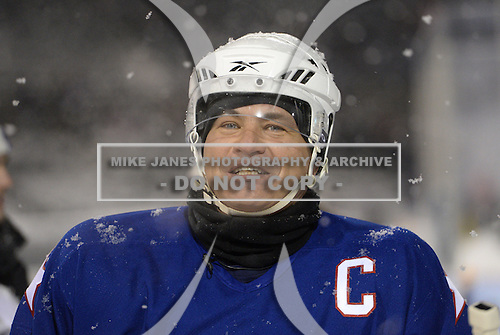 Jody Gage (9) gives an interview in between periods during The Frozen Frontier Buffalo Sabres vs. Rochester Amerks Alumni Game at Frontier Field on December 15, 2013 in Rochester, New York.  (Copyright Mike Janes Photography)