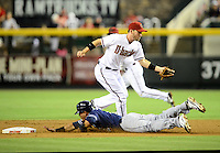 Jul. 3, 2012; Phoenix, AZ, USA: San Diego Padres base runner Everth Cabrera steals second base ahead of the tag by Arizona Diamondbacks shortstop Stephen Drew in the second inning at Chase Field. Mandatory Credit: Mark J. Rebilas-