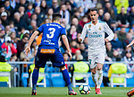 Lucas Vazquez (R) of Real Madrid battles for the ball with Ruben Duarte of Deportivo Alaves during the La Liga 2017-18 match between Real Madrid and Deportivo Alaves at Santiago Bernabeu Stadium on February 24 2018 in Madrid, Spain. Photo by Diego Souto / Power Sport Images