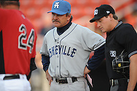 Asheville Tourists Manager Joe Mikulik #20 listens to pregame instructions before a game vs. the Hickory Crawdads at L.P. Franz Stadium in Hickory,  North Carolina;  April 7, 2011.  Hickory defeated Asheville 4-2.  Photo By Tony Farlow/Four Seam Images