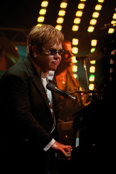 Elton John sings during his White Tie and Tiara Ball