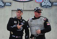 Aug. 7, 2011; Kent, WA, USA; NHRA top fuel dragster driver Larry Dixon (left) jokes with Bob Vandergriff Jr during the Northwest Nationals at Pacific Raceways. Mandatory Credit: Mark J. Rebilas-