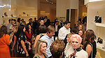 Guests visit at the Vogue Galleria Fashion Show at the Versace pre-party for the Galleria Thursday Sept. 10,2015.(Dave Rossman photo)