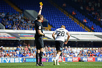 (L-R) Referee Darren England shows George Byers of Swansea City a yellow card during the Sky Bet Championship match between Ipswich Town an Swansea City at Portman Road Stadium, Ipswich, England, UK. Monday 22 April 2019