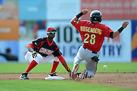 Batavia Muckdogs shortstop Javier Lopez (35) takes a throw as Dante Rosenberg (28) slides in during a game against the State College Spikes on July 28, 2013 at Dwyer Stadium in Batavia, New York.  Batavia defeated State College 10-5.  (Mike Janes/Four Seam Images)