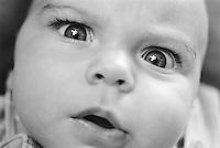 Baby boy (3-6 months), close up (B&W)