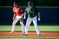 Dartmouth Big Green first baseman Michael Calamari (3) leads off second base in front of shortstop Max Burt (24) during a game against the Northeastern Huskies on March 3, 2018 at North Charlotte Regional Park in Port Charlotte, Florida.  Northeastern defeated Dartmouth 10-8.  (Mike Janes/Four Seam Images)