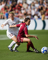 FSU midfielder Erika Sutton (6) dribbles away from USC forward Amy Rodriguez (12).  The University of Southern California defeated Florida State University 2-0 to win the 2007 women's NCAA College Cup in College Station, TX on December 9, 2007.