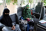 2 June 2013,  Jalalabad, Afghanistan.  Female students Rozina (23, in black at left) and Fatana (22) sitting in a bus waiting to be transported back to town at Nangarhar University in Jalalabad. Over 500 women attend the University and there has so far been no trouble from the Taliban regarding the education of women in Jalalabad.  Many of the facilities and equipment at the University are being provided under the World Bank funded Strengthening Higher Education Program (SHEP). The objective of the program is to restore basic operational performance at a group of core universities in Afghanistan. It aims to act as a catalyst to attract resources at Afghan tertiary education in the long term.  SHEP is the first major education investment in Afghanistan by the World Bank. In 2008 it received $US 5 million from ARTF to expand infrastructure and equipment to Universities in Kabul, Nangarhar , Balkh and Kandahar.  Picture by Graham Crouch/World Bank