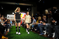 FC Gold Pride players Leslie Osborne and Christina DiMartino walk down the runway during the unveiling of the Women's Professional Soccer uniforms at the Event Place in Manhattan, NY, on February 24, 2009. Photo by Howard C. Smith/isiphotos.com