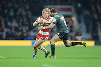 Billy Twelvetrees of Gloucester Rugby looks for a way past Jamie Roberts of Harlequins during the Aviva Premiership Rugby match between Harlequins and Gloucester Rugby at Twickenham Stadium on Tuesday 27th December 2016 (Photo by Rob Munro/Stewart Communications)