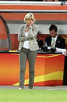 Wolfsburg , 100711 , FIFA / Frauen Weltmeisterschaft 2011 / Womens Worldcup 2011 , Viertelfinale ,  Deutschland (GER) - Japan (JPN) .Trainerin Silvia Neid (GER) nachdenklich .Foto:Karina Hessland .