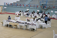 07 October 2019, Tunisia, Tunis: Members of Tunisia's Independent High Authority for Elections count the ballots at a vote counting station a day after the parliamentary election.