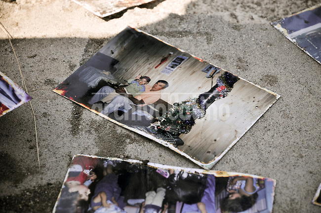 Chile, Aftermath of the tsunami in the area of Consitucion. The son of Sofia Monsalve with his grandfather. They both disappeared in the see after the tsunami.