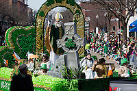 A man dressed as St. Patrick waves from a float in the 2013 annual St. Patrick's Day Parade in South Boston, Boston, Massachusetts, USA.