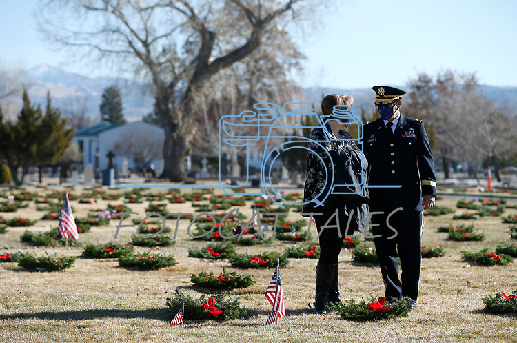 Nevada National Guard Brigadier General Michael Hanifan and his wife Denise participate in the National Wreaths Across America Day at the Lone Mountain Cemetery, in Carson City, Nev., on Saturday, Dec. 19, 2020. The program honors veterans at more than 2100 cemeteries around the world. <br /> Photo by Cathleen Allison/Nevada Momentum Fueled by RAD