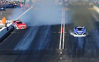 Feb. 19, 2012; Chandler, AZ, USA; NHRA funny car driver Johnny Gray (left) hits the wall alongside Robert Hight during the Arizona Nationals at Firebird International Raceway. Mandatory Credit: Mark J. Rebilas-