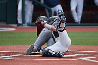 Liberty Flames catcher Gray Betts (2) tags out Davis Crane (50) of the Bellarmine Knights at Liberty Baseball Stadium on March 9, 2021 in Lynchburg, VA. (Brian Westerholt/Four Seam Images)