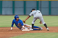 AZL Cubs 2 first baseman Fidel Mejia (17) slides safely into second base around the tag of White Sox shortstop Camilo Quinteiro (1) during an Arizona League game against the AZL White Sox at Sloan Park on July 13, 2018 in Mesa, Arizona. The AZL Cubs 2 defeated the AZL White Sox by a score of 6-4. (Zachary Lucy/Four Seam Images)