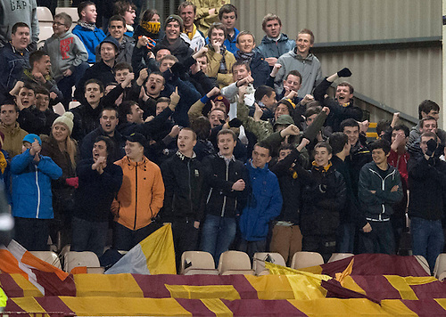 PICTURE BY - ROB CASEY .DESCRIPTION - MOTHERWELL v DUNFERMLINE.PIC SHOWS - MOTHERWELL FANS DO THE HIGDON.