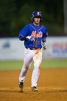 Luis Carpio (11) of the Kingsport Mets hustles towards third base against the Elizabethton Twins at Hunter Wright Stadium on July 8, 2015 in Kingsport, Tennessee.  The Mets defeated the Twins 8-2. (Brian Westerholt/Four Seam Images)