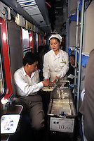 Service worker sells lunch box to the passenger on the Beijing to Hong Kong long-distance train, Beijing, China.