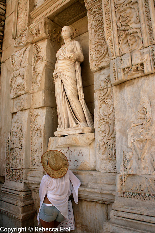 TOURIST AT THE LIBRARY OF CELSUS, EPHESUS, TURKEY