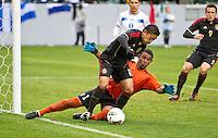 CARSON, CA - March 25, 2012: Marco Fabian (10) of Mexico and Jose Mendoza (1) of Honduras during the Mexico vs Honduras match at the Home Depot Center in Carson, California. Final score Mexico 3, Honduras 0.