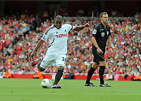 Pictured: Kemy Agustien of Swansea takes a shot off target from a free kick. Saturday 10 September 2011<br /> Re: Premiership Arsenal v Swansea City FC at the Emirates Stadium, London.