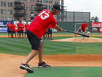 July 5, 2009: Pitching coach Bob Kipper (13) of the Greenville Drive works with his pitchers in a fielding drill prior to a game against the Savannah Sand Gnats at Fluor Field at the West End in Greenville, S.C. Photo by: Tom Priddy/Four Seam Images