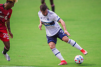ORLANDO, FL - APRIL 24: Lucas Cavallini #9 of Vancouver Whitecaps dribbles the ball during a game between Vancouver Whitecaps and Toronto FC at Exploria Stadium on April 24, 2021 in Orlando, Florida.
