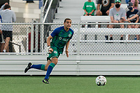 HARTFORD, CT - AUGUST 17: Gabriel Torres #16 of Hartford Athletic brings the ball forward during a game between Charleston Battery and Hartford Athletic at Dillon Stadium on August 17, 2021 in Hartford, Connecticut.