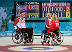 Sochi, RUSSIA - Mar 10 2014 -  Mark Idesonm and Dennis Thiessen shake hands after defeating USA during Canada vs USA in Wheelchair Curling round robin play at the 2014 Paralympic Winter Games in Sochi, Russia.  (Photo: Matthew Murnaghan/Canadian Paralympic Committee)