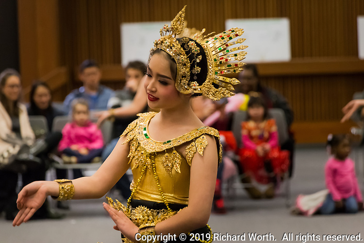 A dancer with the Thai Cultural Council of Berkeley in traditional dress, performs a Thai folk dance during a Lunar New Year Celebration