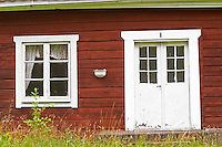 Traditional style Swedish wooden painted house. A door Window Smaland region. Sweden, Europe.