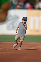 Kane County Cougars young fan participates in the base race promotion during a Midwest League game against the Dayton Dragons on July 20, 2019 at Northwestern Medicine Field in Geneva, Illinois.  Dayton defeated Kane County 1-0.  (Mike Janes/Four Seam Images)