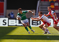24th April 2021; Brentford Community Stadium, London, England; Gallagher Premiership Rugby, London Irish versus Harlequins; Tom Parton of London Irish breaks the tackle of Andre Esterhuizen of Harlequins