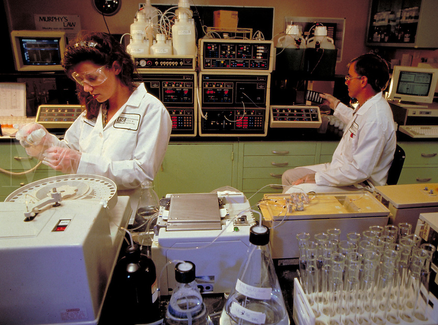 Laboratory testing for environmental pollutants. Pollution. Environment. occupations, protective clothing, biology, chemicals, ecology, man, woman, men, women, laboratory, lab, equipment.