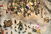 Christmas tree decorated with village scene. Providence Festival of Trees. Portland. Oregon