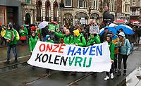 Nederland -  Amsterdam - 10 Maart 2019.  De Klimaatmars. De protestmars trekt door het centrum van Amsterdam naar het Museumplein. Groen Links uit Rotterdam. Foto mag niet in negatieve / schadelijke context voor de gefotografeerde personen worden gepubliceerd.