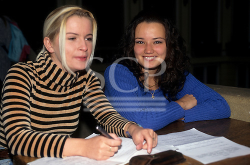 Debrecen University, Hungary. Two female students working on papers at a desk in the university.