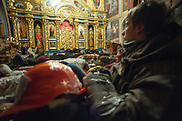 People sleeping in Mykhailovskyi Monastery, which allowed protestors to sleep during cold winter nights in Kiev and hide from attack of riot police. The Kiev patriarchy widely supports the protesters and opens door of all temples for those who do not have place to sleep. Traditionally Kiev patriarchy is opposed by pro-Russian Russian Patriarchy, which has not made any statements for now.